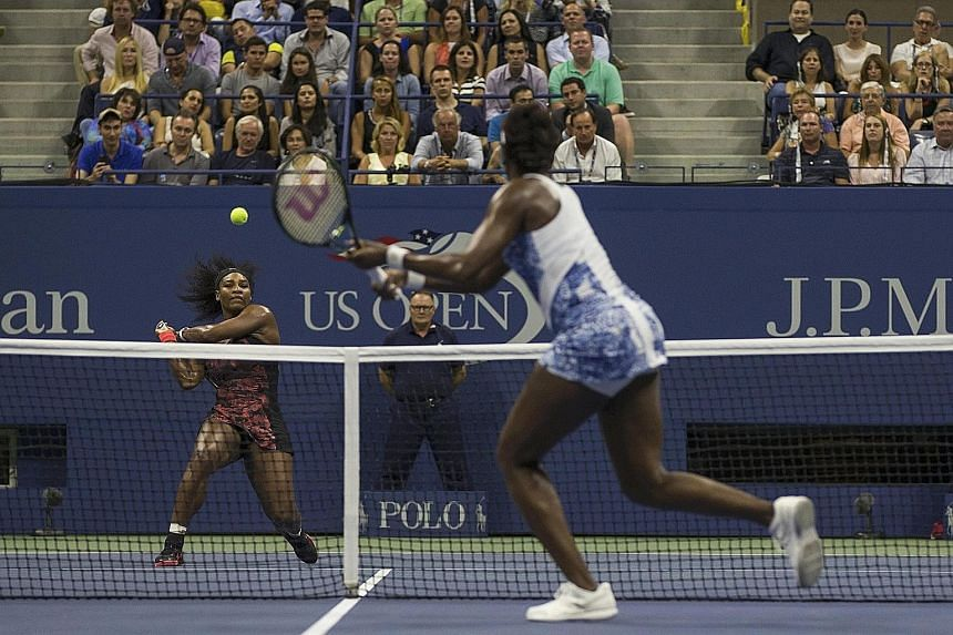 Serena Williams (left) stays on course for a happy ending at the US Open after she overcomes sister Venus in their quarter-final showdown which was watched by celebrities like US presidential candidate Donald Trump and television mogul Oprah Winfrey.