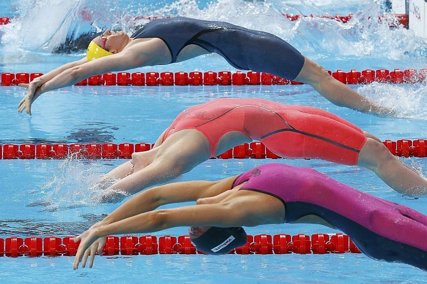 From top: Australia's Emily Seebohm got the better of Missy Franklin of the US in the 200m backstroke at the World Championships in Kazan last month.