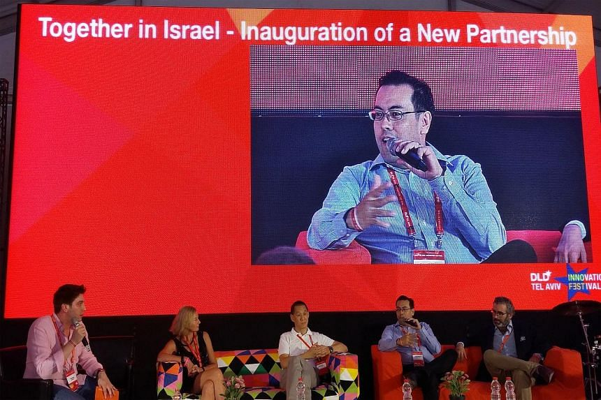 Singtel Innov8 CEO Edgar Hardless speaking at the launch of the partnership at the DLD Conference in Tel Aviv, with representatives from Orange, Deutsche Telekom and Telefonica.