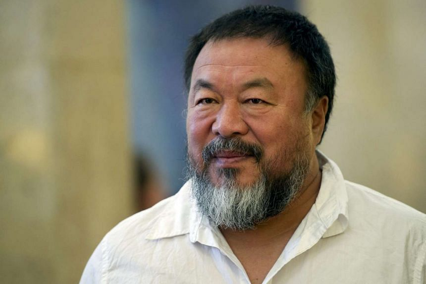 Dissident Chinese artist Ai Weiwei arrives at the town hall in Berlin, Germany on Aug 13, 2015.