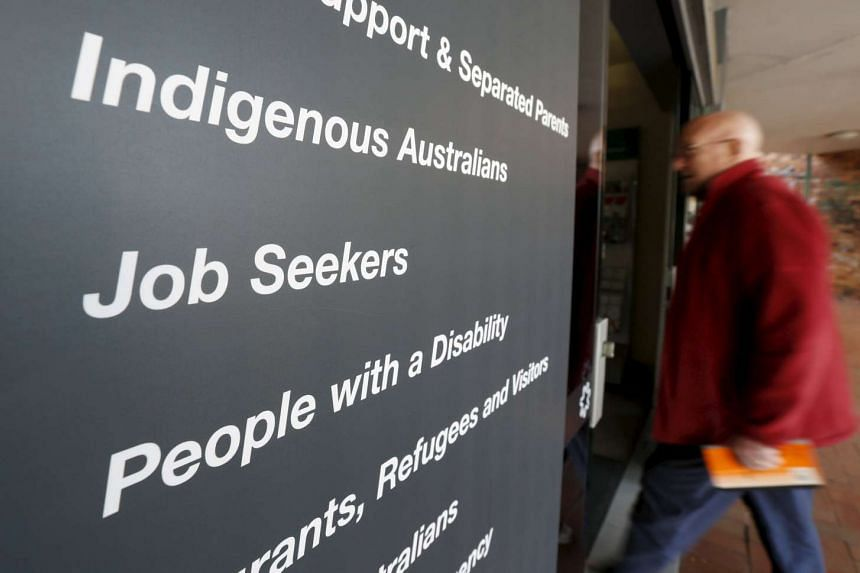 A man walking into a Centrelink, part of the Australian government's department of human services where job seekers search for work, in a Sydney suburb.