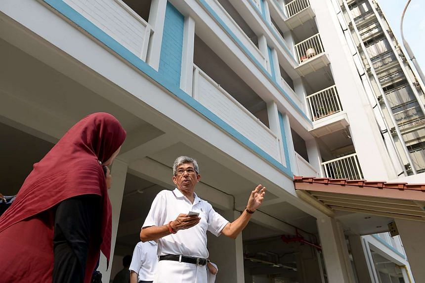 Minister-in-charge of Muslim Affairs Yaacob Ibrahim speaking to a Jalan Besar resident during a walkabout on Sept 6.