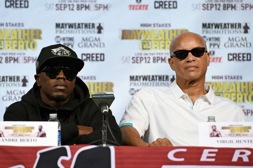 Boxer Andre Berto (left) and his trainer Virgil Hunter attend a news conference at MGM Grand Hotel & Casino on Sept 9, 2015 in Las Vegas, Nevada.