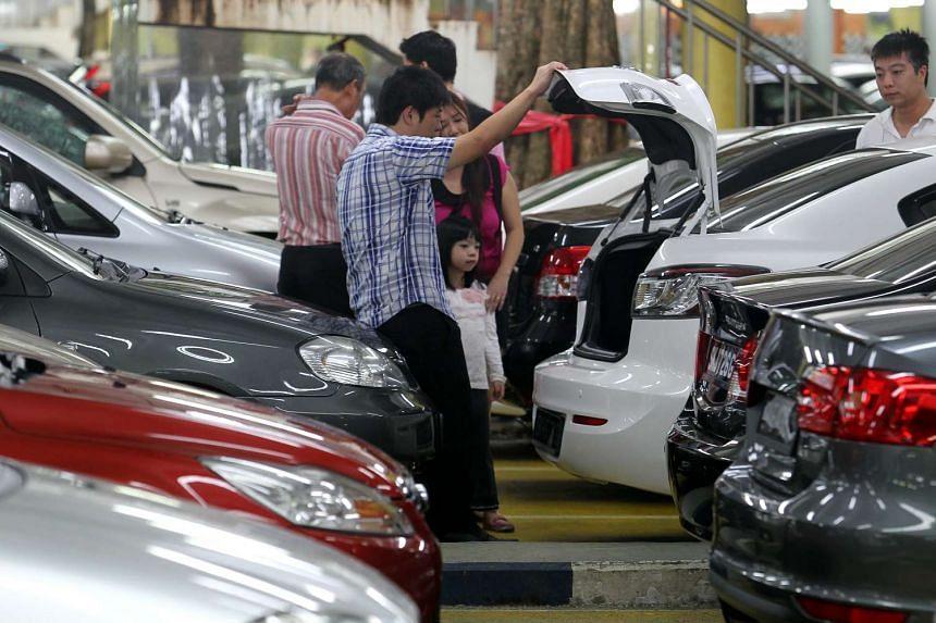 Customers at a used car showroom at Turf City.