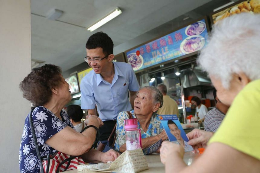 Workers' Party's Bernard Chen meeting residents during a walkabout on Sept 5.