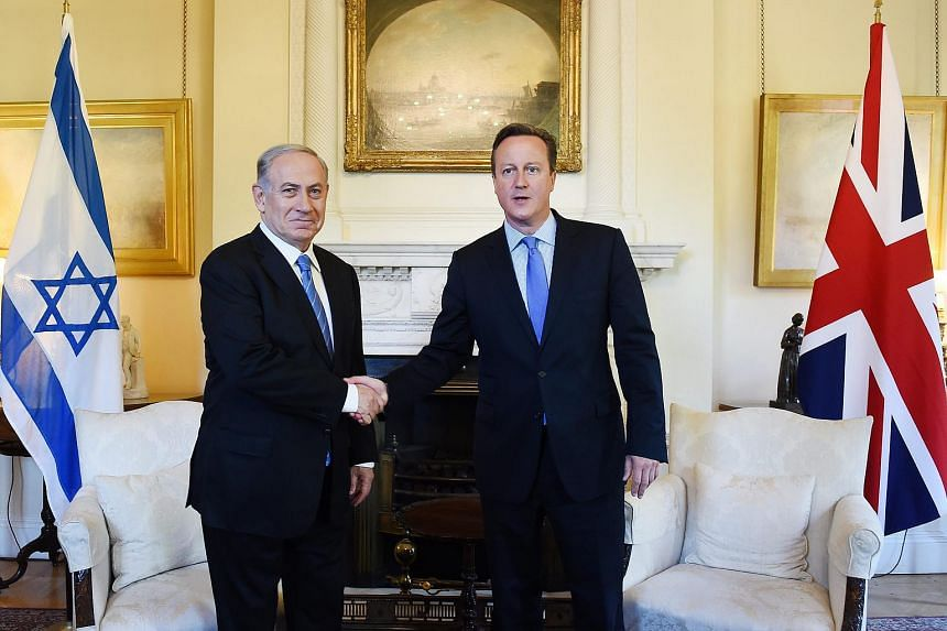 British Prime Minister David Cameron (right) shakes hands with Israeli Prime Minister Benjamin Netanyahu at 10 Downing Street in London on Sept 10, 2015.