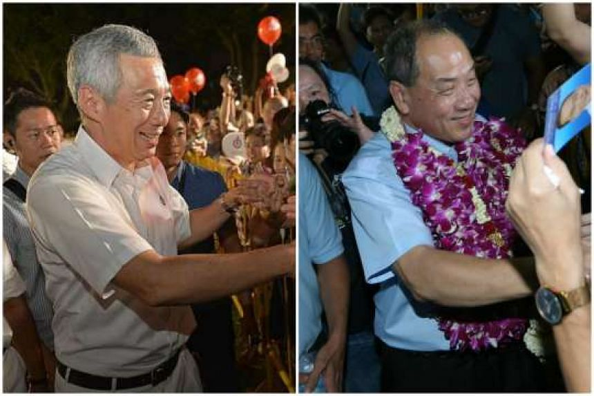 Prime Minister Lee Hsien Loong (left) and Workers' Party chief Low Thia Khiang meeting the people attending the PAP and WP rallies in Boon Keng Road and Bedok Stadium respectively, on the final day of campaigning last night.
