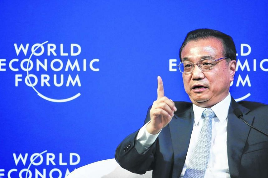 China's Premier Li Keqiang answers a question during a meeting with executives from foreign companies at the World Economic Forum (WEF) in China's port city Dalian on Sept 9, 2015.