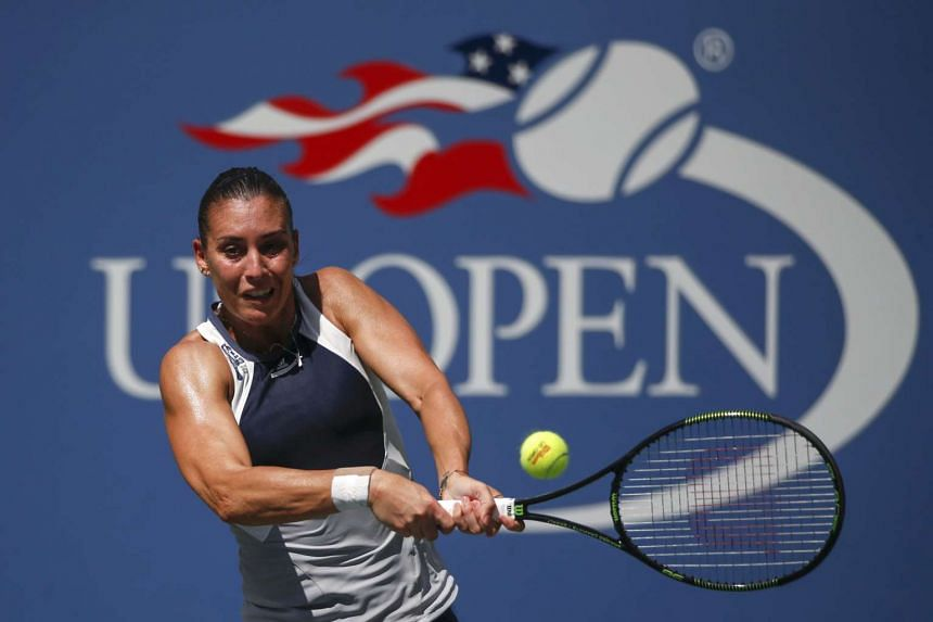 Italy's Flavia Pennetta returns a shot during her match against Petra Kvitova of the Czech Republic.