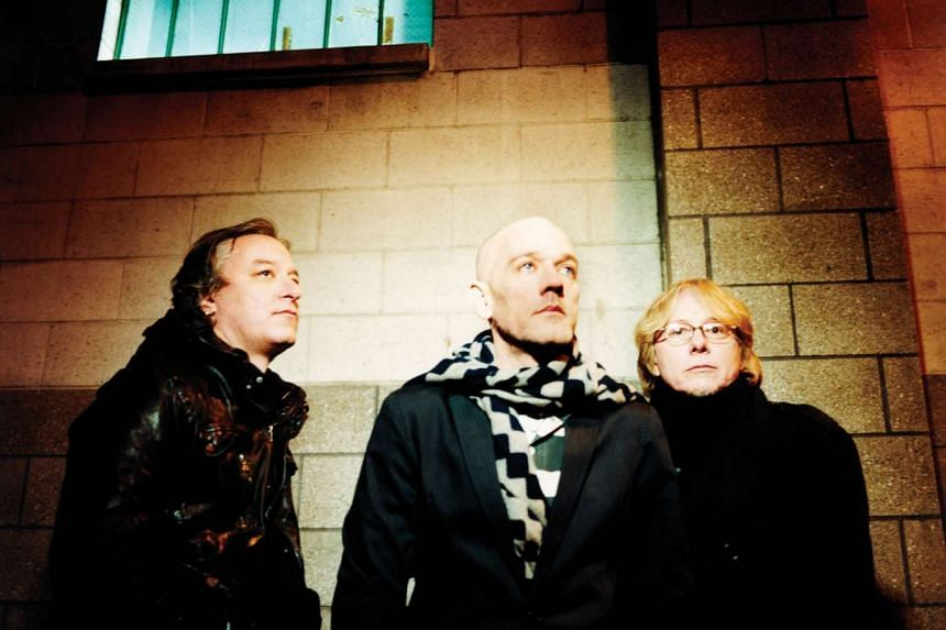 (From left) REM guitarist Peter Buck, vocalist Michael Stipe and bassist Mike Mills.