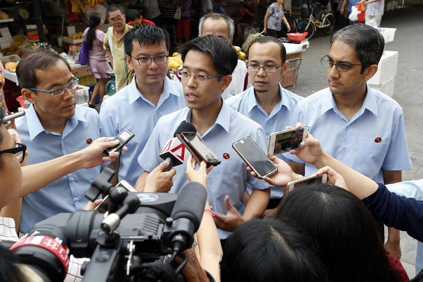 WP candidate for East Coast GRC Gerald Giam talking to reporters. With him are fellow candidates (from left) Dennis Tan (Fengshan SMC), Daniel Goh, Mohamed Fairoz Shariff and Leon Perera (East Coast GRC).