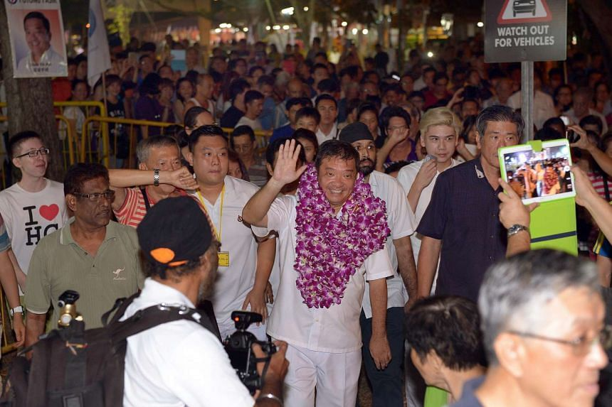 A garlanded Mr Sitoh Yih Pin, the PAP candidate for Potong Pasir SMC, thanking supporters at the end of his rally last night.