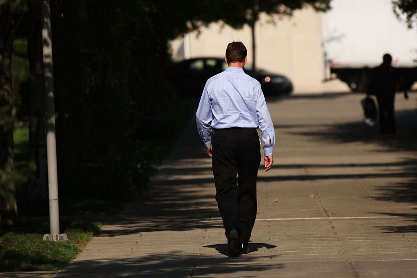 A businessman walks through downtown Stamford on Sept 9, 2015 in Stamford, Connecticut.