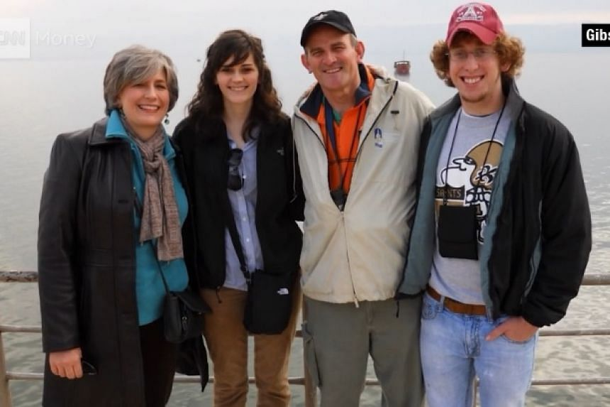 A screenshot from the CNN report on US pastor John Gibson's suicide, showing the Gibson family.