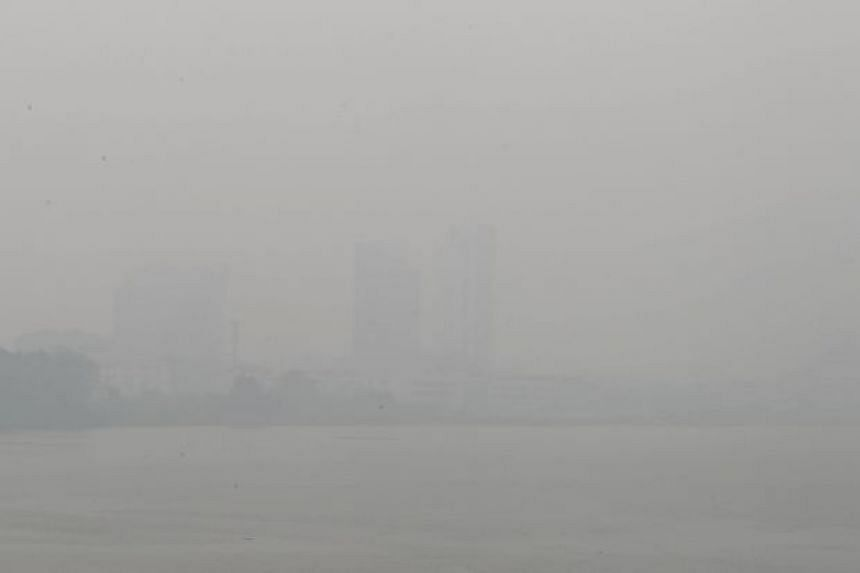 Visibility is almost zero at the Sarawak River in Kuching, which is shrouded in haze.