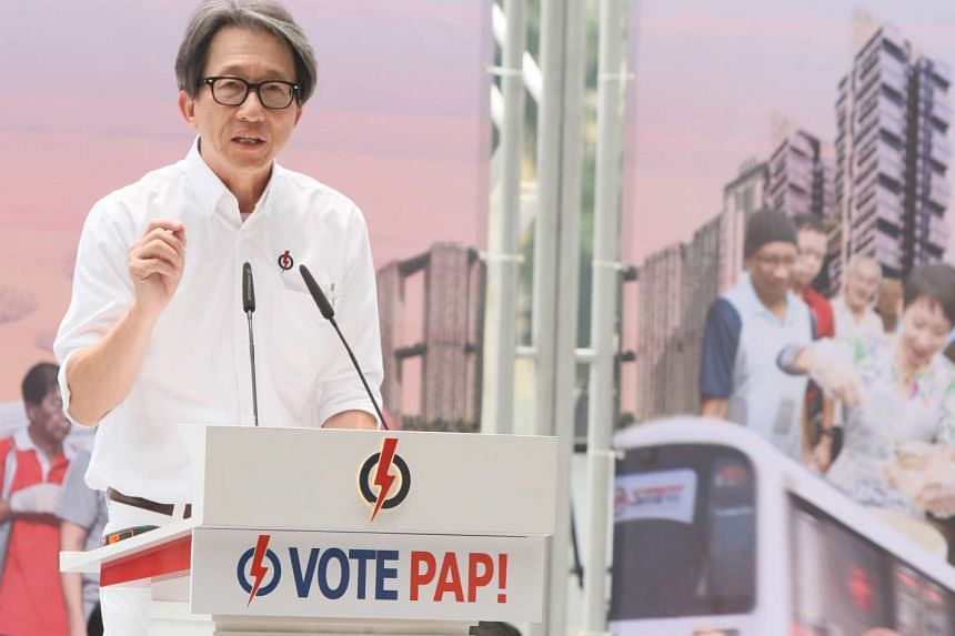 Manpower Minister Lim Swee Say speaking at the PAP's lunchtime rally at UOB Plaza on Sept 8.