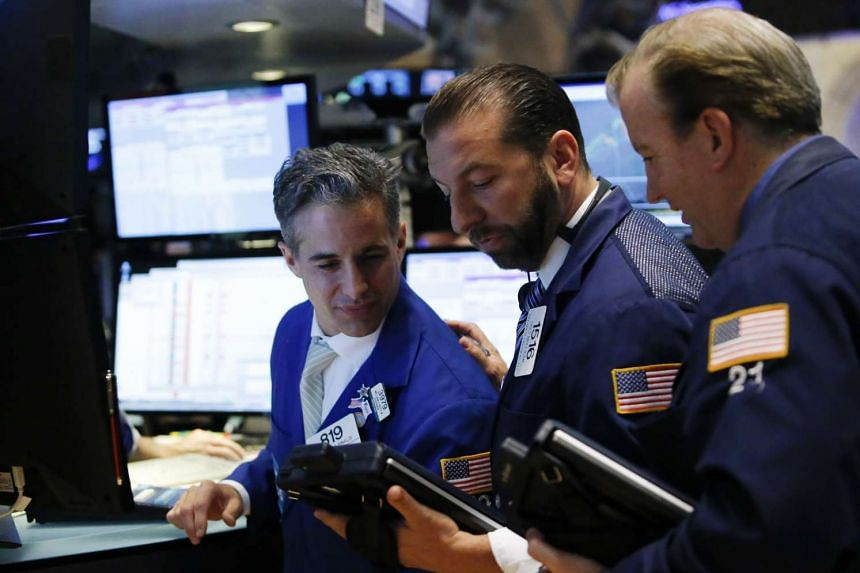Traders work on the main trading floor of the New York Stock Exchange shortly after the closing bell in New York on June 17, 2015.