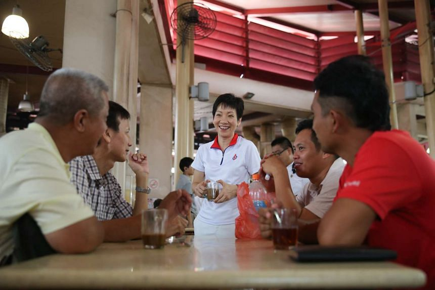 Ms Grace Fu meeting residents during her walkabout at Yuhua Village Market and Hawker Centre on Sept 4, 2015.