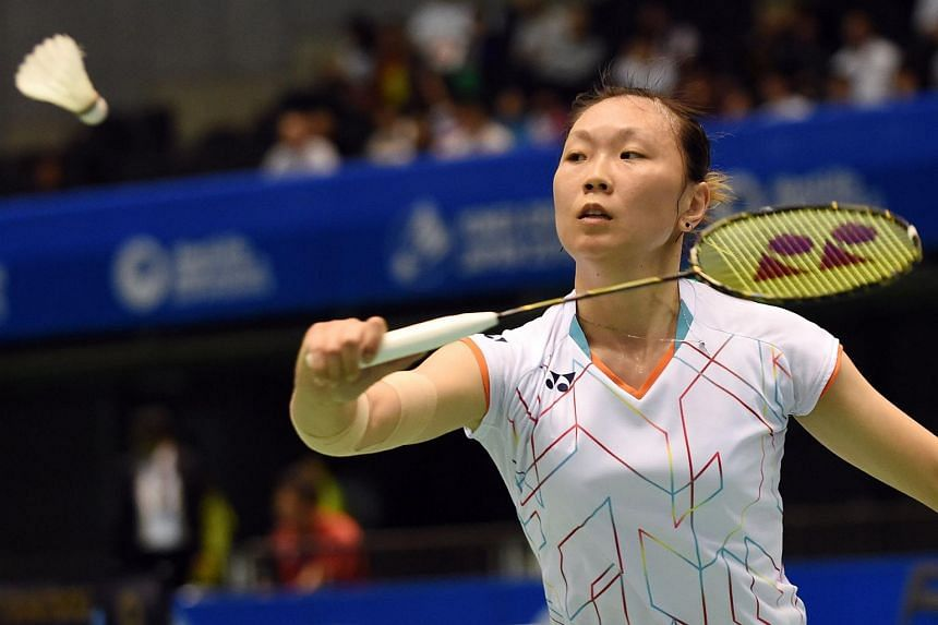 Beiwen Zhang of the US hits a return against Akane Yamaguchi of Japan during their women's singles second round match at the Japan Open Superseries badminton tournament in Tokyo on Sept 10, 2015.