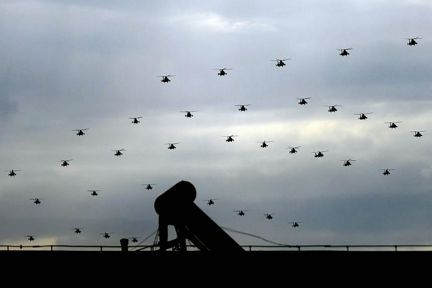 Chinese military helicopters take part in a rehearsal ahead of a military parade to mark the 70th anniversary of the end of World War II, in Beijing on Aug 23, 2015.