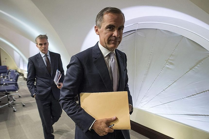 "BOE Governor Mark Carney (right) says the decision on when to lift interest rates will come into ""sharper"" focus at the start of next year."