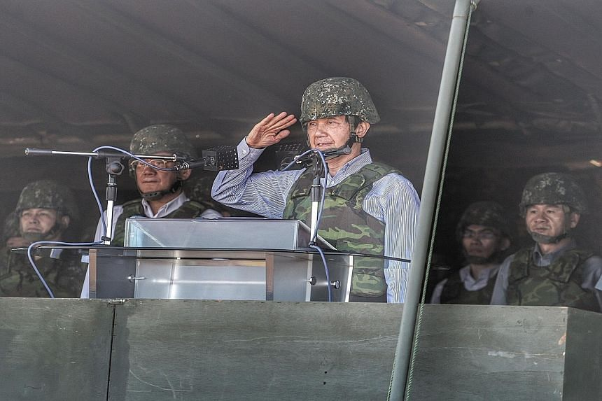 Taiwan President Ma Ying-jeou saluting during the Han Kuang 31 live fire drill in Hsinchu, northern Taiwan, yesterday.