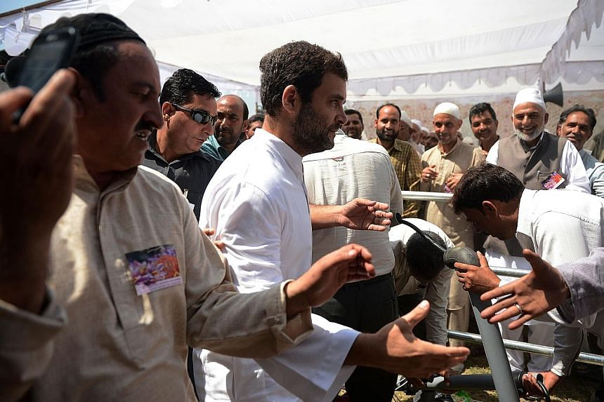 Mr Rahul Gandhi (centre) meeting saffron farmers last month while on a three-day visit to Jammu and Kashmir. The Congress party vice-president has spoken up for the rights of the common folk, from farmers and fishermen to home buyers and students.