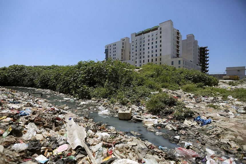 Trash piling up around Gleneagles Khubchandani Hospital in Mumbai. Parkway Pantai, a subsidiary of IHH Healthcare, has been forced to delay its opening, originally planned for 2012, while awaiting the necessary permits.