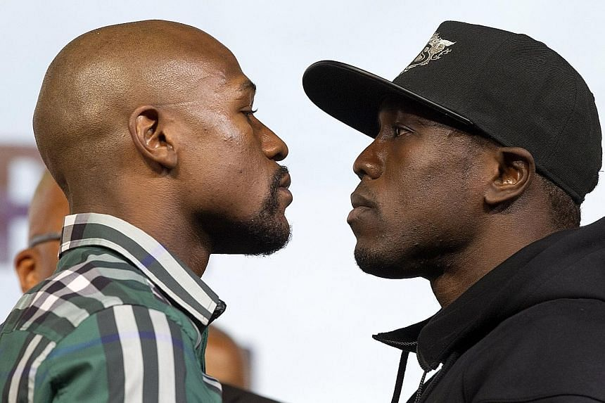 Floyd Mayweather (far left) and challenger Andre Berto in an intense face-off after their news conference at the MGM Grand Hotel & Casino in Las Vegas on Wednesday.