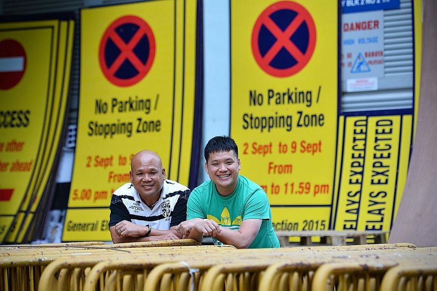 S-Lite Event Support founder Thomas Ang (left) and his son Vernon. Sporting events account for more than 70 per cent of its business, with the rest being community and cultural showpieces.