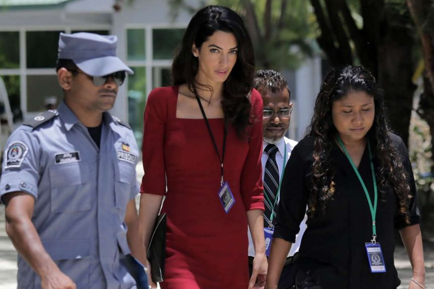 Human rights lawyer Amal Clooney (centre) leaves Maafushi Prison on Sept 10, 2015.