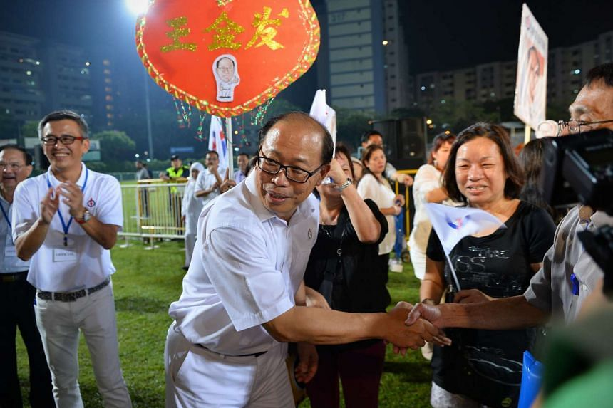 PAP candidate David Ong shaking hands with his supporters at the end of a PAP rally on Sept 7, 2015.