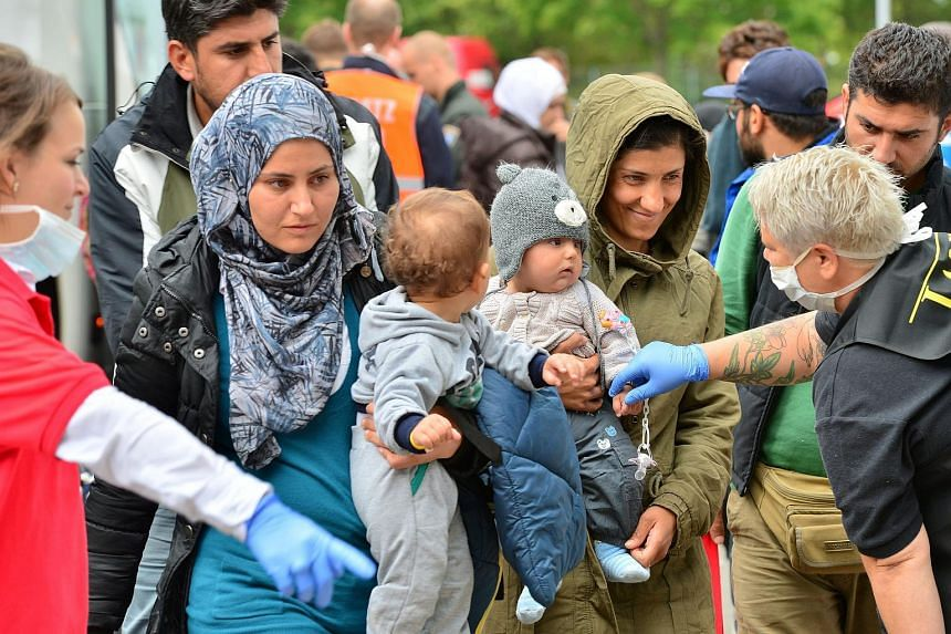 Refugees arriving at the exhibition centre in Erfurt, Germany on Sept 8, 2015.