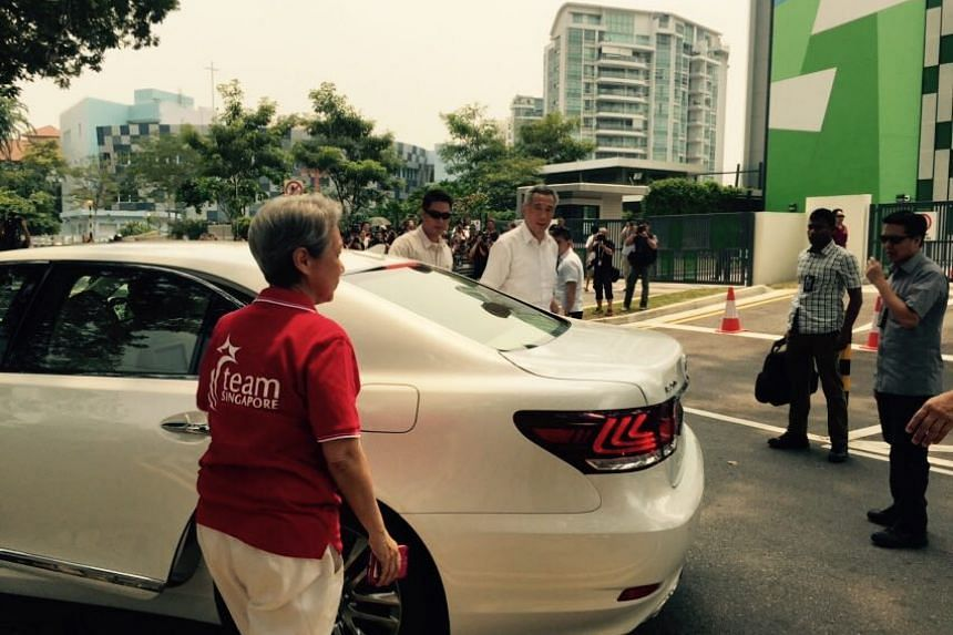PM Lee Hsien Loong arriving to vote at Alexandra Primary School with his wife, Ms Ho Ching.