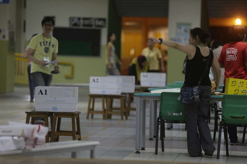 Polling agents and officials packing up at Bukit Panjang Primary School as polling closes at 8pm on Sept 11, 2015.