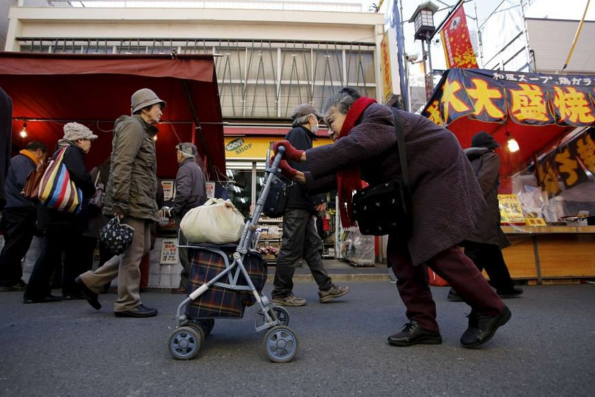 An old woman in Tokyo's Sugamo district, an area popular among the Japanese elderly.