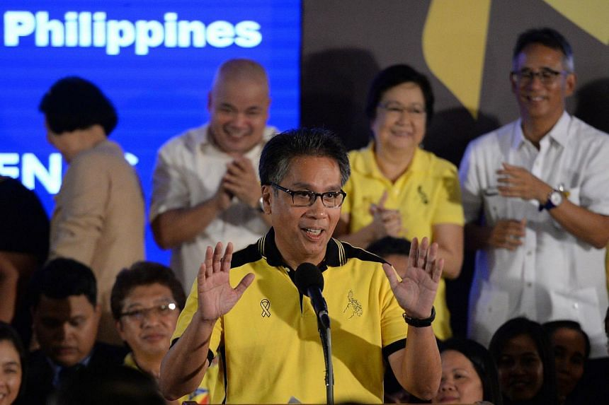 Philippine Interior Minister Manuel Roxas gestures as he delivers a speech during a ceremony in Manila on July 31, 2015.