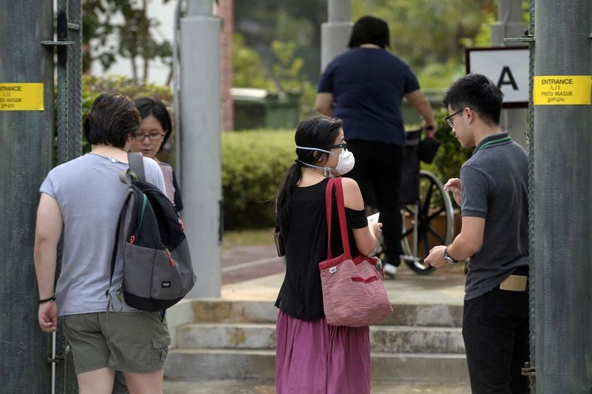 Voters on their way to cast their ballot at Nanyang Girls' High School.