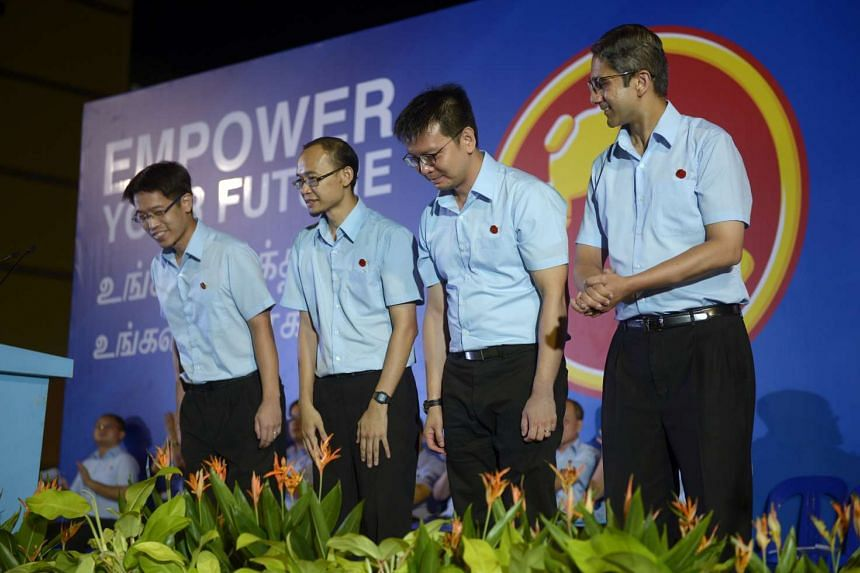 WP's East Coast GRC candidates (from left) Mr Gerald Giam, Mr Mohamed Fairoz Shariff, Mr Daniel Goh and Mr Leon Perera rally at the field in front of Blk 155, Simei Road.