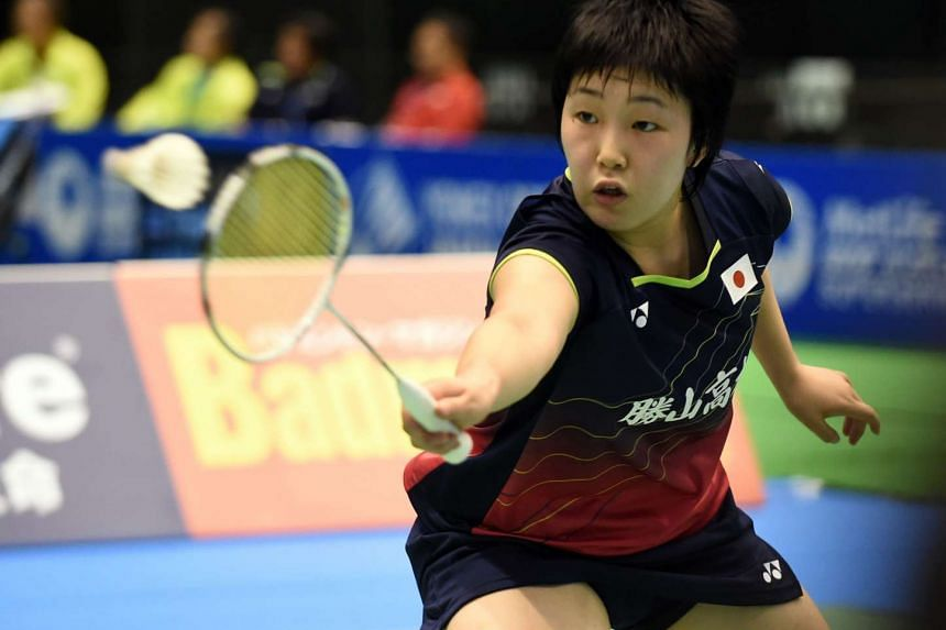 Akane Yamaguchi of Japan hits a return against eighth-seeded Sung Ji Hyun of South Korea during their Japan Open Superseries badminton tournament women's singles first round match in Tokyo on Sept 9, 2015.