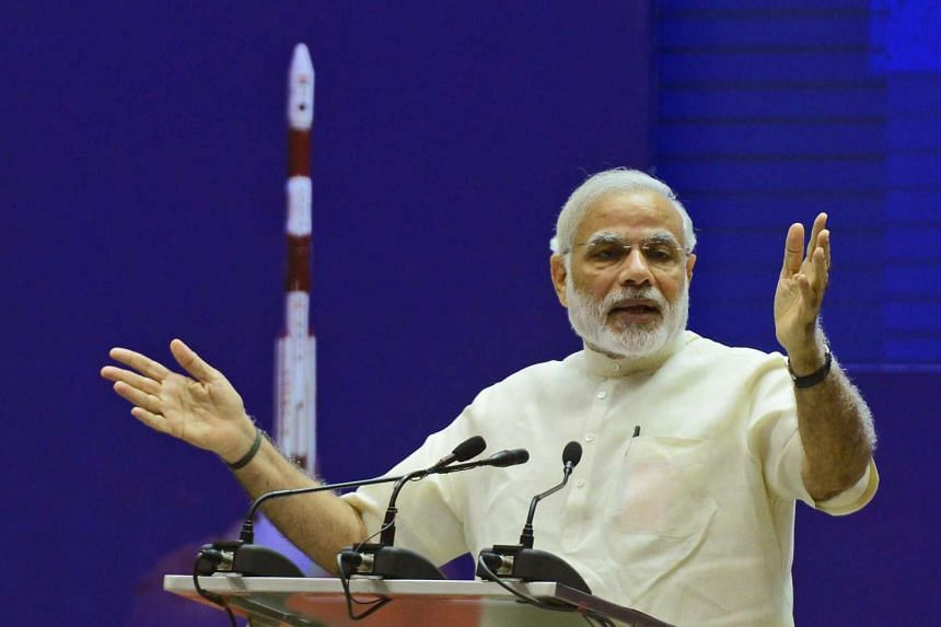 Indian Prime Minister Narendra Modi addresses a national meeting on 'Promoting Space Technology based Tools and Applications in Governance and Development' in New Delhi, India, Sept 7, 2015.