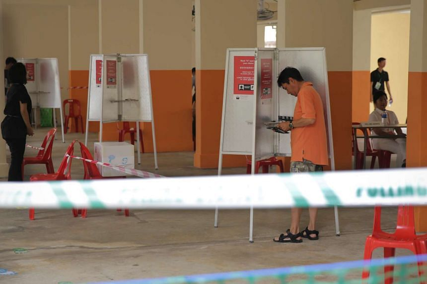 Voters at a polling station at Block 136, Bukit Batok West Avenue 6.