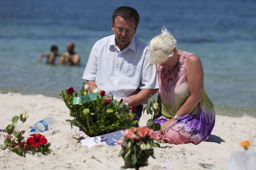 Tourists mourn at the site of the shooting in June 2015 which left 30 Britons dead.