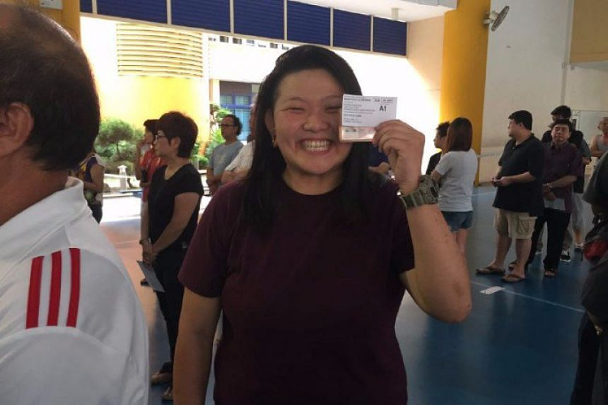 """First-time voter and full-time Uber driver Joanne Quek, 25, went to Pei Chun Public School to vote once her shift ended. """"I'm pretty excited, but have mixed feelings as well. Four years ago I stayed up all night to watch the results on TV. Getting in"""