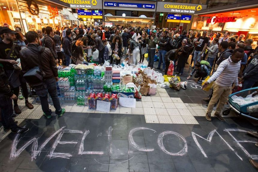 Supplies set up next to a welcome message in readiness for the arrival of refugees at Frankfurt's main station on Sep 5, 2015.