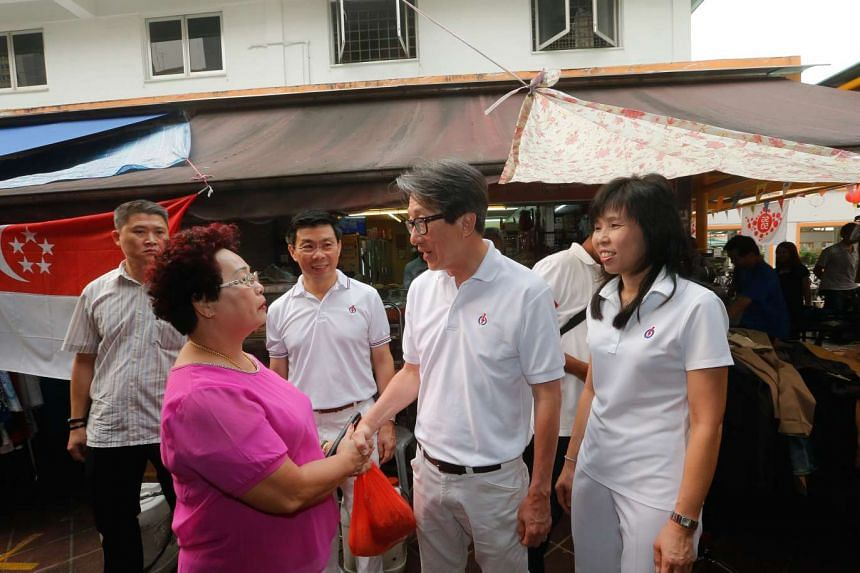 East Coast GRC MPs-elect (from left) Lee Yi Shyan, Lim Swee Say and Jessica Tan thanking residents at Block 16, Bedok South Road Market and Food Centre.