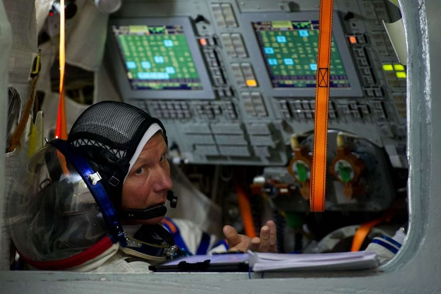 Russian cosmonaut Gennady Padalka, seen here in a file photo from March 2015, returned safely to Earth on Sept 12, 2015, with the record for having spent the most time in space - 879 days.