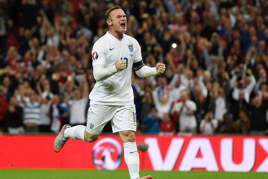 Manchester United's Wayne Rooney celebrates after scoring the 2-0 goal during the UEFA EURO 2016 Group E qualification match between England and Switzerland on Sept 8, 2015.