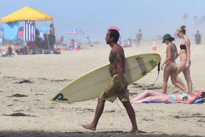 A surfer at Huntington Beach in California on Sept 10, 2015, during a heat wave.