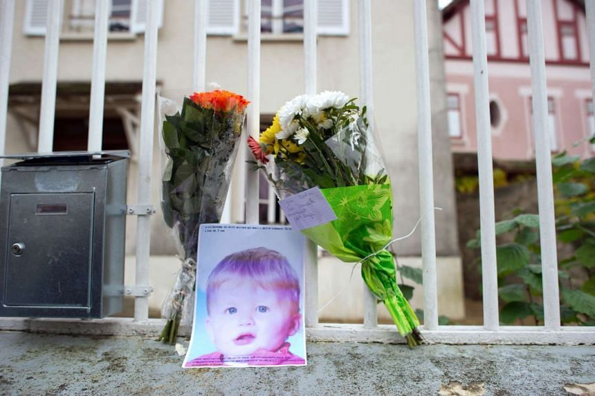 A picture taken on Nov 28, 2011 of a photo of three-year-old Bastien at the entrance of his parents' house in Germigny-l'Eveque, east of Paris.